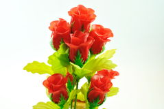 Red roses represent love. Red roses and green leaves on a white background stock photography