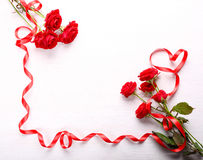 Red roses and ribbon Royalty Free Stock Photo
