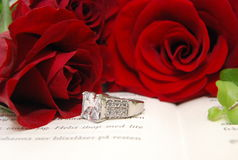 Red roses and a ring stock image
