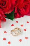 Red roses, rings and sugar hearts for Valentine's Day Royalty Free Stock Photos