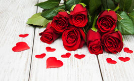 Red roses with silk hearts Stock Images
