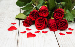Red roses with silk hearts Stock Photography