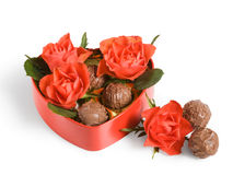 Red roses and truffles Stock Photo