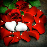 Red roses and two hearts. Valentines Day or Wedding vintage Royalty Free Stock Images