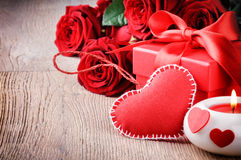 Red roses and Valentin's gift stock photos