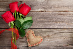 Red roses and Valentine's day heart Stock Photography