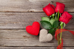 Red roses and Valentine's day hearts Stock Photo