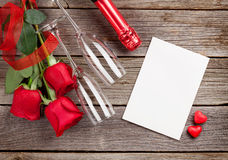 Red roses with Valentines day card and champagne Stock Photo