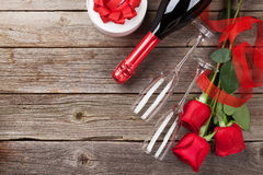 Red roses with Valentines day gift and champagne Royalty Free Stock Photos