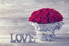 Red roses. In a vase Royalty Free Stock Images
