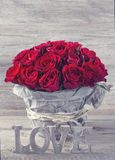 Red roses. In a vase Stock Photos
