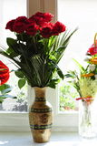 Red Roses in Vase. A dozen red roses in a vase by the window Royalty Free Stock Photo