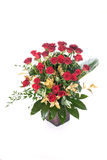 Red roses in vase. Red roses with green and gold leafs in a glass vase stock photos