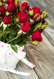 Red roses in vase Royalty Free Stock Image