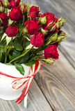 Red roses in vase Royalty Free Stock Photography