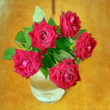 Red roses in vase on a wooden Stock Images