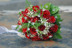 Red roses wedding bouquet. On the rusty well Royalty Free Stock Image
