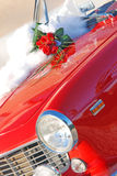 Red roses wedding bouquet. On the on the red sport car Royalty Free Stock Photography