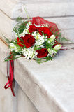 Red roses wedding bouquet. At the white stone Royalty Free Stock Photography