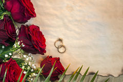 Red Roses - Wedding Day. Red roses are often used as a symbol of love. Wedding Day and Wedding rings. Genus Rosa, family Rosaceae.  Space for text Stock Images