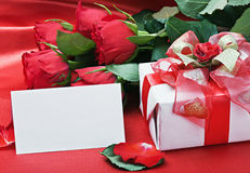 Red roses and white card Royalty Free Stock Images