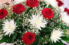 Red roses and white chrysanthemums. A bunch of red roses and white chrysanthemums royalty free stock photography