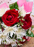 Red roses and white flowers in bouquet. Close up picture of Red roses and white flowers in bouquet Stock Photos