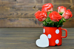 Red roses and white heart Stock Image