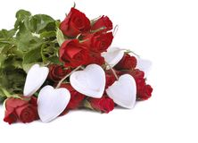 Red roses and white hearts. Bouquet of red roses with white hearts isolated on white background Stock Image
