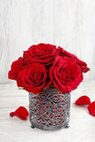 Red roses on white wooden background Royalty Free Stock Images