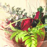 red roses in a wicker basket Royalty Free Stock Photography