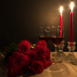 Red roses, wine and candles Stock Photo
