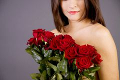 Red roses and a woman Stock Images