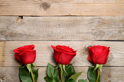 Red roses on wood Royalty Free Stock Photography