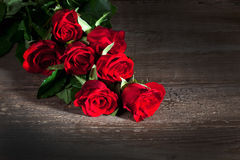 Red roses, wooden background stock image