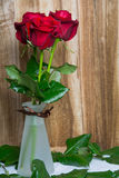 Red roses on wooden background. With space for text royalty free stock photos