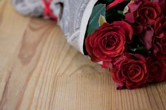 Red roses on wooden table stock photo