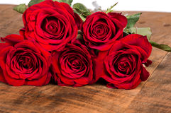 Red roses on a wooden table Royalty Free Stock Images