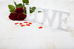 Red roses and the word Love Stock Photography