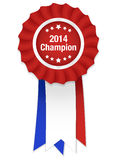 Red rosette with white label 2014 champion and tri. Color ribbon Stock Image
