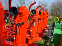 Agricultural machinery, red rotary mowers. Red rotary mowers machine,  farm Stock Photography