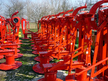 Agricultural machinery, red rotary mowers Royalty Free Stock Photos