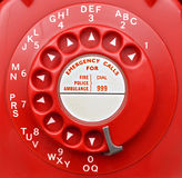Red Rotary Telephone Dial. Close up of vintage sixties 706l gpo UK red rotary telephone dial Stock Photography
