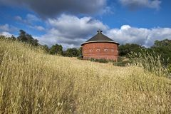Red round barn small windows royalty free stock photo