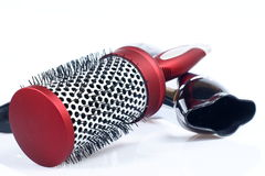 Red round comb and hairdryer Royalty Free Stock Image