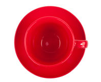 Red round empty tea cup on a saucer Stock Photo