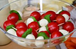 Red Round Fruit Served on Clear Glass Bowl Stock Images