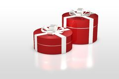 Red round gift box with white ribbon Stock Photos