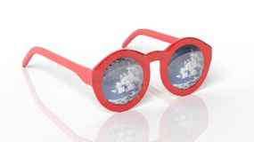 Red round-lens sunglasses with blue sky, clouds and sun reflection on lens Royalty Free Stock Photo