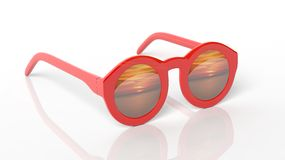 Red round-lens sunglasses with sunset reflection on lens Stock Photos